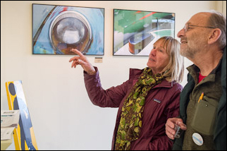 Ada Brown and Bill Light looking at the art